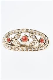 Sale 8293 - Lot 366 - A 9CT GOLD STONE SET EDWARDIAN STYLE RING; oval frame set with cabochon corals and seed pearls, size N-O.