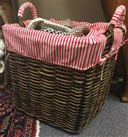 Sale 8310A - Lot 385 - A wicker basket with red striped insert