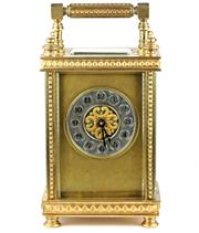 Sale 8402W - Lot 74 - A BRASS CARRIAGE CLOCK; of customary form with pyramid decoration, silver chapter dial with Arabic numerals, turned feet and finials...