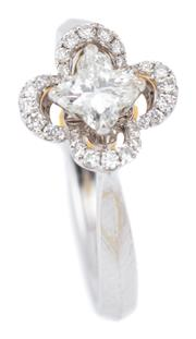 Sale 9083 - Lot 461 - AN 18CT WHITE GOLD DIAMOND FLOWER RING; island set with a quatrefoil brilliant cut diamond of approx. 0.50ct, VS,  surrounded by 28...