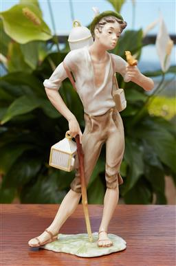 Sale 9099 - Lot 258 - A Bavarian ceramic figure of a boy, repaired arm, Height 21cm