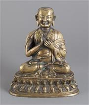 Sale 8536 - Lot 37 - An important 18th century gilt bronze Lama in the seated position, the smiling face flanked by prominent ears, the base sealed and i...