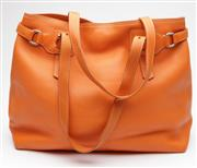 Sale 9074 - Lot 358 - A PRADA ORANGE PEBBLE LEATHER TOTE; magnetic stud closure to top, two adjustable strap handles, one small internal zipped compartmen...