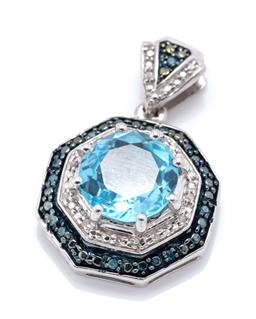 Sale 9253J - Lot 473 - A SILVER TOPAZ AND DIAMOND PENDANT; centre claw set with a round cut blue topaz to double octagonal surround and triangular bale set...