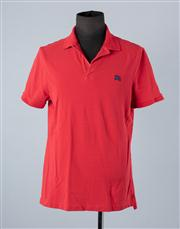 Sale 8770F - Lot 91 - A Burberry Brit cotton polo in red, size XL