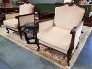 Sale 8792 - Lot 1059 - A pair of carved walnut armchairs in the Louis XV style, upholstered in a cream fabric