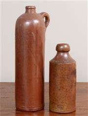 Sale 8868H - Lot 77 - Two earthenware bottles, one Bourne Denby made for Josiah Russell the other example Rotterdam, taller 30cm