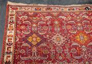 Sale 8942H - Lot 26 - A Persian wool carpet with herati pattern in orange and red tones, 214cm x 131cm