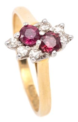 Sale 9132 - Lot 342 - A GOLD RUBY AND DIAMOND RING; set on the diagonal in 9ct white gold with 2 round cut rubies and 6 single cut diamonds on 18ct gold b...