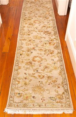 Sale 9150H - Lot 160 - A Persian hand knotted woollen runner in a floral repeating pattern on grey ground, 400cm x 75cm