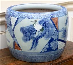 Sale 9190H - Lot 263 - An antique Japanese porcelain jardinere C: 1895. The lake scenes with fishing boats and water birds framed by florals. Ht: 31cm x D:...
