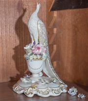 Sale 8435A - Lot 46 - A Royal Crown Derby peacock on urn base with floral decoration some losses, H 22cm