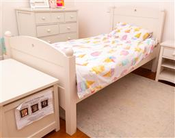 Sale 9150H - Lot 162 - A cream painted single bed with star cutout detail with bedding, Height of headboard 110cm