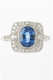 Sale 8280 - Lot 371 - AN 18CT WHITE GOLD DECO STYLE GEMSTONE CLUSTER RING; centring an blue oval sapphire of approx. 1.50ct to a surround and shoulders se...