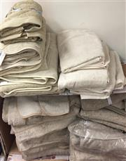 Sale 8310A - Lot 389 - Four bales of beige towels, various sizes, including a robes