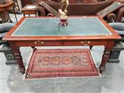 Sale 8714 - Lot 1055 - Edwardian Possibly Maple Library Table, with tooled green leather top, fitted with 2 frieze drawers on turned legs.