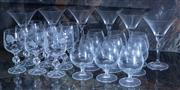 Sale 8568A - Lot 168 - Two shelf lots of stemwares including cognac, some engraved with angel fish, and martini glasses