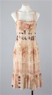 Sale 8685F - Lot 95 - A Galliano, Italian made printed silk slip dress with lace trim and keyhole detail to bust, size IT 26/40