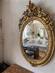 Sale 9040H - Lot 61 - A pair of Antique gilded oval mirrors  (condition commensurate with age)  height 1.23m 78cm wide 12cm depth
