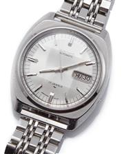 Sale 9074 - Lot 355 - A VINTAGE SEIKO AUTOMATIC WRISTWATCH; ref; 7009-8100 in stainless steel with sunburst dial, applied markers, center seconds, day dat...