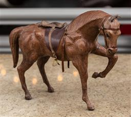Sale 9160H - Lot 186 - A leather model of a horse, Height 27cm x Length 32cm