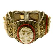 Sale 8065 - Lot 301 - A SILVER GILT CAMEO BRACELET; 3 cannetille work panel links each set with a carved figural cameo to a coral bead border.
