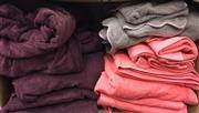 Sale 8310A - Lot 390 - A box of grey towels, various sizes, including maroon, coral and mushroom towels, including a robe
