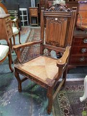 Sale 8634 - Lot 1072 - French Beech Armchair, with linen fold panel back & woven rush seat, on sabre style legs