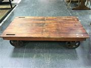 Sale 8643 - Lot 1123A - Timber Top Coffee Table on Vintage Railway Wheels