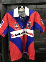 Sale 8805A - Lot 860 - Signed Knights Jersey. A kids Newcastle Knights jersey, inscribed by Andrew Johns.
