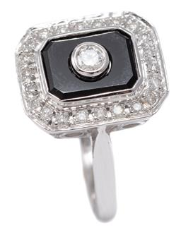 Sale 9156J - Lot 383 - AN ART DECO STYLE ONYX AND DIAMOND RING; bezel set round brilliant cut diamond on an onyx plaque surrounded by a further 22 diamonds...