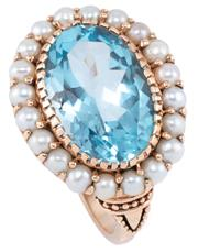 Sale 8954 - Lot 355 - A GEORGIAN STYLE 9CT GOLD GEMSTONE RING; centring an approx. 7ct blue oval topaz surrounded by 2.5mm round pearls, size K.