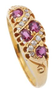 Sale 8999 - Lot 376 - AN EDWARDIAN 18CT GOLD RUBY AND DIAMOND RING; belcher set with 9 rose and old round cut diamonds and 4 round cut rubies, hallmarked...