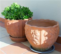 Sale 9165H - Lot 208 - A Pair of terracotta frill top planters with fruit decoration, height 33cm.