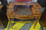 Sale 8255 - Lot 1076 - Small Yewwood Veneered Ladys Desk, with seven drawers & small leather writing surface, by Reprodux