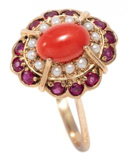Sale 9156J - Lot 352 - AN EDWARDIAN STYLE CORAL AND GEMSET CLUSTER RING; centring a 7.2 x 5mm oval cabochon coral surrounded by seed pearls and round cut r...