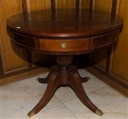 Sale 7981B - Lot 13 - A pair of Mahogany Regency design Drum Tables each with 4 drawers raised on a central column with 4 brass capped reeded sabre legs....