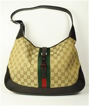Sale 8460F - Lot 24 - A classic Gucci Jackie O style shoulder bag with brown leather base and handle, beige ebony GG Supreme canvas, green and red web, gu...
