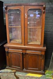 Sale 8520 - Lot 1063 - Victorian Mahogany Bookcase with Two Glass Panel Doors above Two Drawers and Arch Panel Doors.