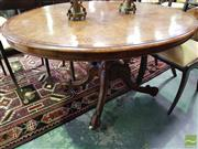 Sale 8539 - Lot 1032 - Good Victorian Burr Walnut Loo Table, the oval top with fine marquetry & probably thuya cross-banding, on turned birdcage base with...