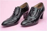 Sale 8661F - Lot 34 - A pair of Tods patent leather brogue heels, size 38