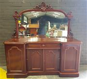 Sale 8956 - Lot 1025 - Victorian Mahogany Mirrored Back Breakfront Sideboard with carved mirror back, a drawer and four shaped panel drawers. (H:190 x W:18...