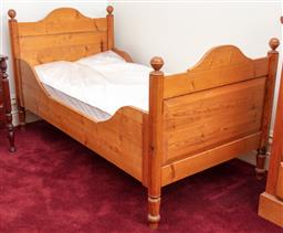 Sale 9190H - Lot 315 - An antique camel back panelled pine bed C: 1890, each end with ball finials and shaped pine sides. The bed on vase and tulip turned ...