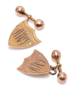 Sale 9209J - Lot 348 - A PAIR 9CT GOLD VINTAGE CUFF LINKS BY SAUNDERS; engraved shield shape fronts to dumbbell backs, size 20 x 16.5mm, wt. 4.9g.