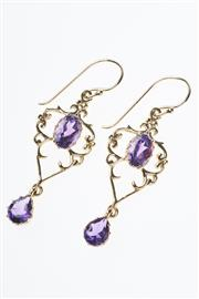 Sale 8293 - Lot 363 - A PAIR OF 9CT GOLD AMETHYST EARRINGS; nouveau inspired frames set with oval cut amethysts to pear cut amethysts drops.