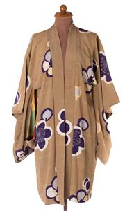 Sale 8550F - Lot 154 - A vintage silk short kimono, with stylised cherry blossom design on a mushroom ground, to tie-dyed silk interior.