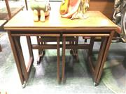Sale 8643 - Lot 1144 - McIntosh Teak Nest of Tables with fold over top