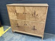 Sale 9056 - Lot 1022 - Art Deco 4 Door Parlour Cabinet with Inlaid Doors and Fitted Interior (h:128 x w:137 x d:46cm)