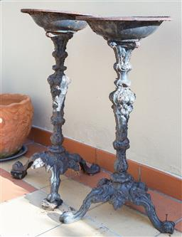 Sale 9165H - Lot 9 - A pair of wrought iron tripod torcheres. Height 74cm