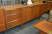 Sale 8235 - Lot 1021 - McIntosh Teak Sideboard with Central Doors flanked by 6 Drawers